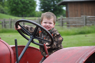 Kids have all kinds of fun on the farm, petting farm animals, driving the tractor, climbing areas and much more at the Downey's Farm in Caledon, Ontario.